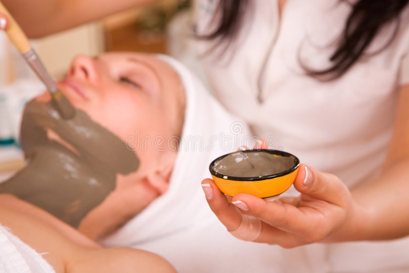 Face care. Beautiful woman having a face care therapy stock image