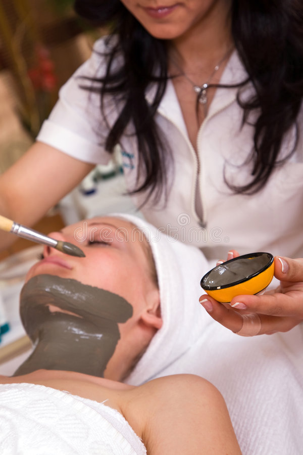 Face care beauty treatment. At the spa center royalty free stock photo