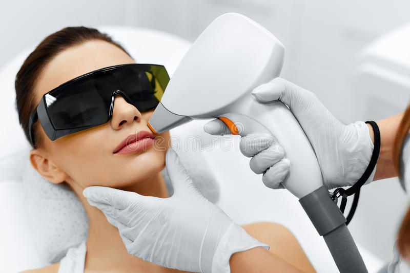 Face Care. Facial Laser Hair Removal. Epilation. Smooth Skin. Face Care. Facial Laser Hair Removal. Beautician Giving Laser Epilation Treatment To Young Woman's stock images