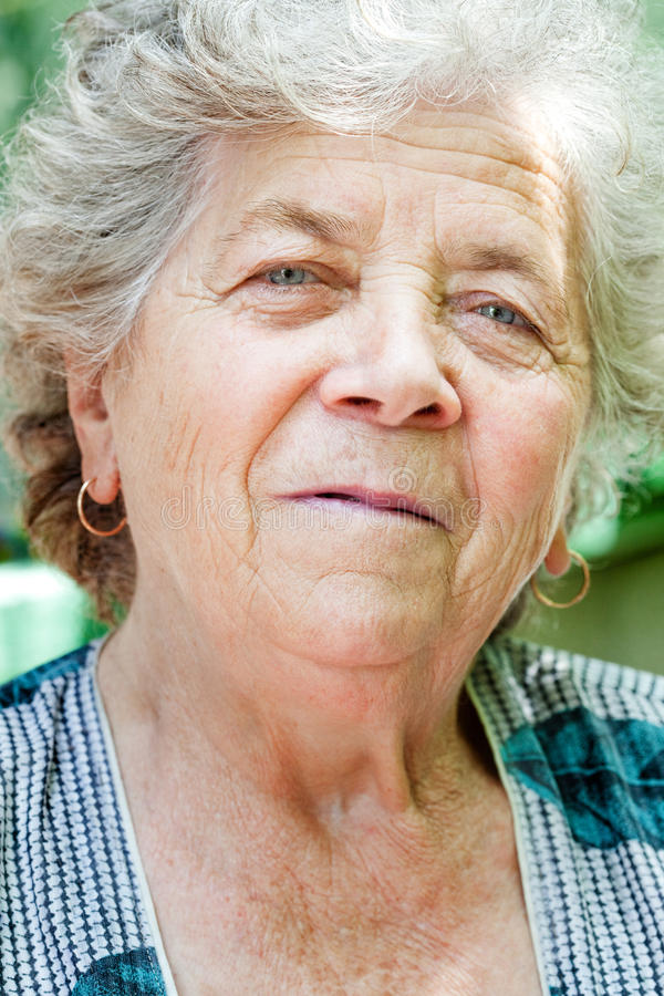 Face of charming senior old woman royalty free stock photos