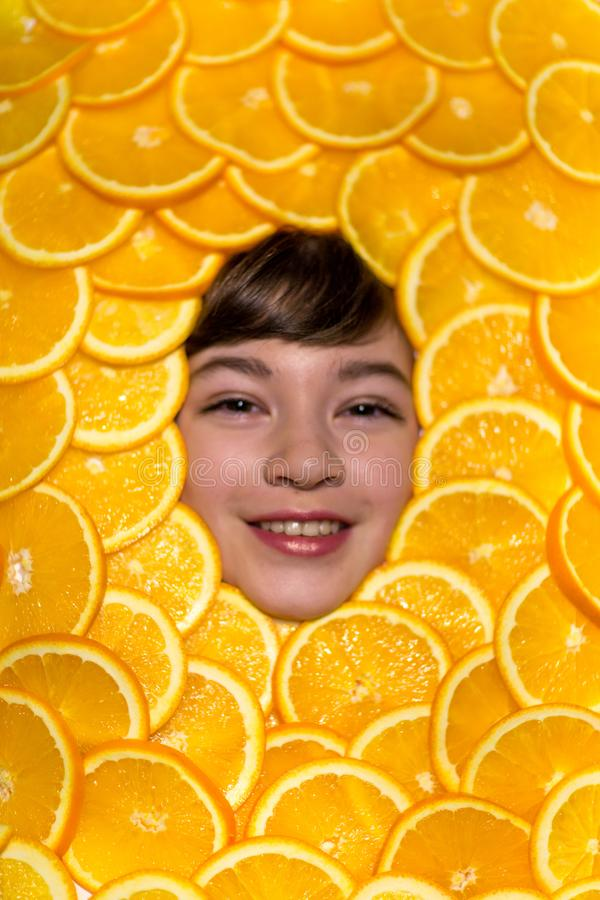 The face of a Child in oranges royalty free stock photography