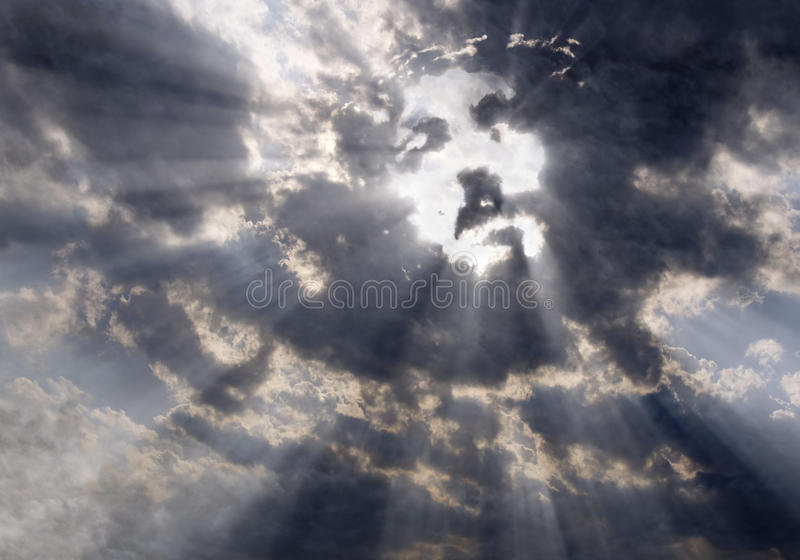 The face of Christ in the sky. Dramatic clouds with sunbeams formed the face of Jesus Christ