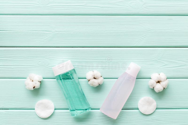 Mycelial water, lotion and cotton pads for skin care on mint green background flat lay space for text royalty free stock image