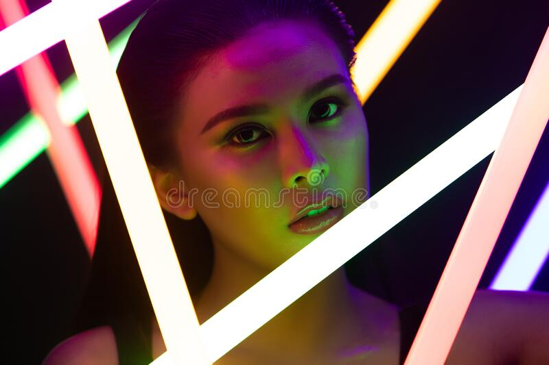 Face Close up of High Fashion Trend Cosmetic make up with NEON stock images