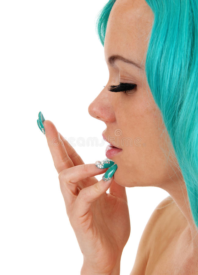 Face closeup of girl. A closeup of halve of the face of a you pretty woman with blue hair and blue fingernails, with eyes closed, isolated for white background stock photo