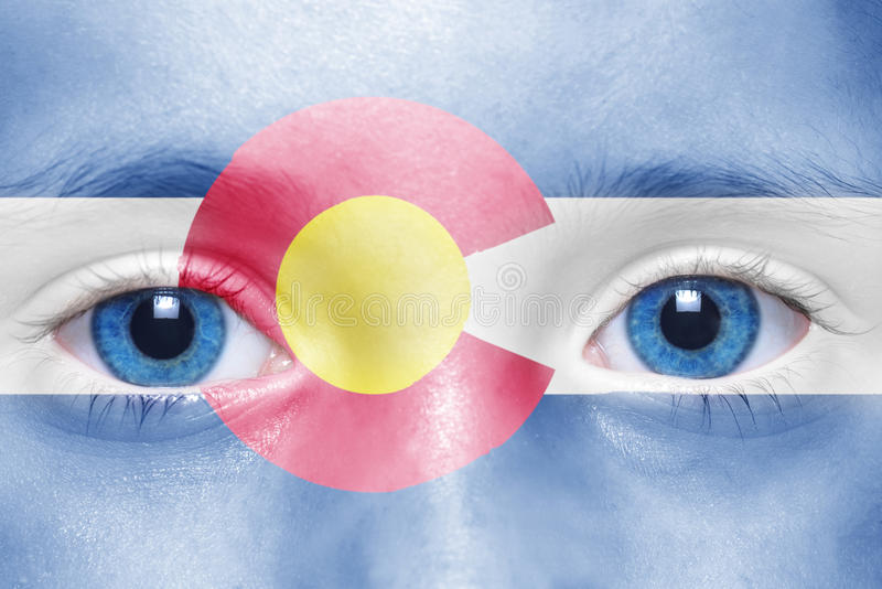 Face with colorado state flag. Human`s face with colorado state flag royalty free stock photo