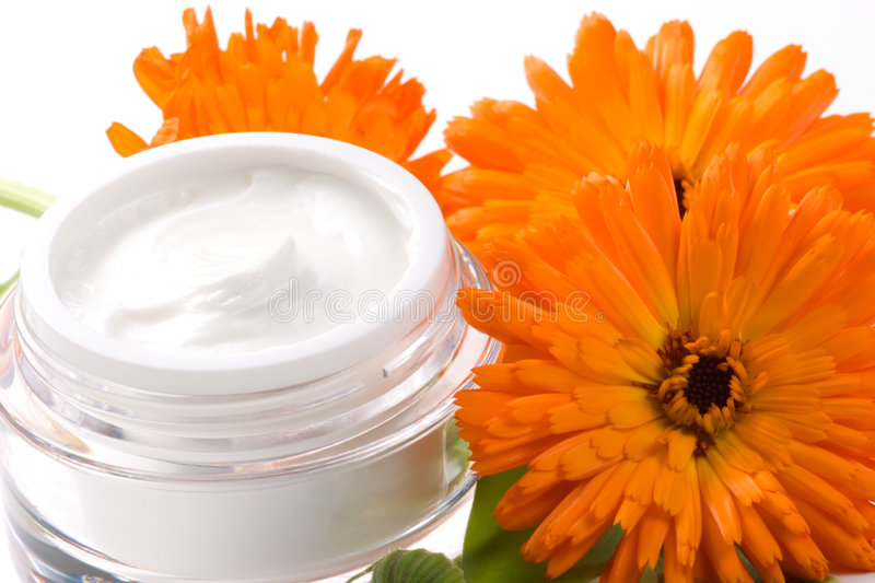 Face cream and calendula flower royalty free stock photo