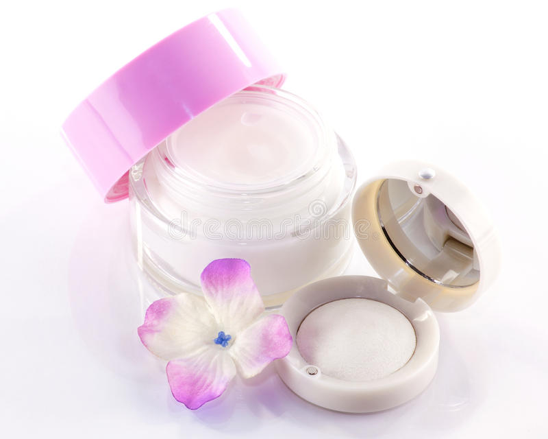 Face-cream and eyeshadow stock photo