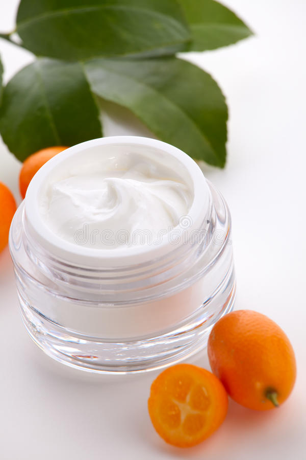 Face cream and fresh cumquats stock image