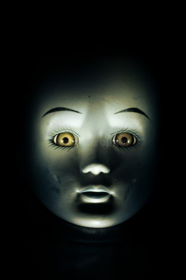 Face da boneca da criança do assombro imagens de stock