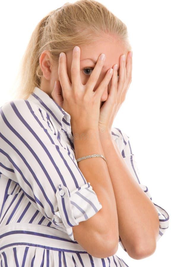 Face da coberta da mulher com mãos fotos de stock