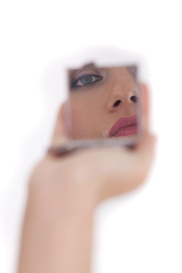 Face da mulher no espelho imagens de stock royalty free