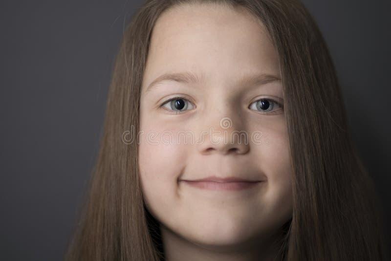 Face de sorriso da menina foto de stock