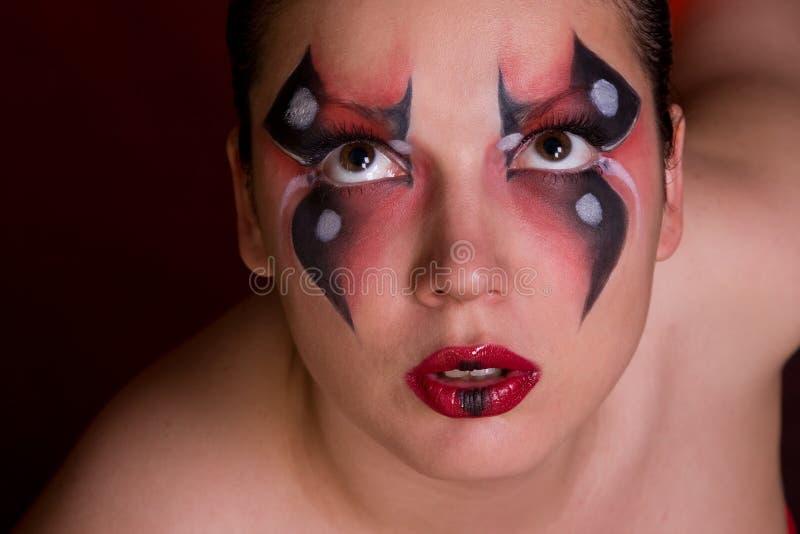 Face de uma mulher com pintura de corpo como a aranha fotografia de stock