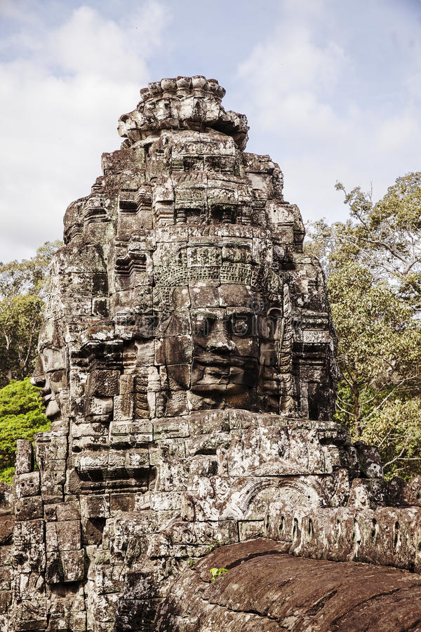 Face Detail At Bayon Temple. One face in the a small tower in the Bayon Temple in the Angkor Thom complex in Cambodia. The temple has over 136 of these faces royalty free stock photography