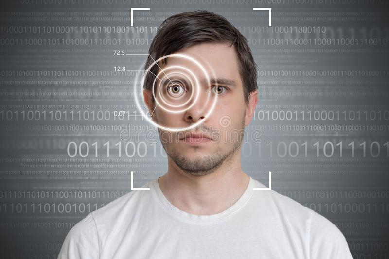Face detection and recognition of man. Computer vision concept. Binary code in background royalty free stock photos