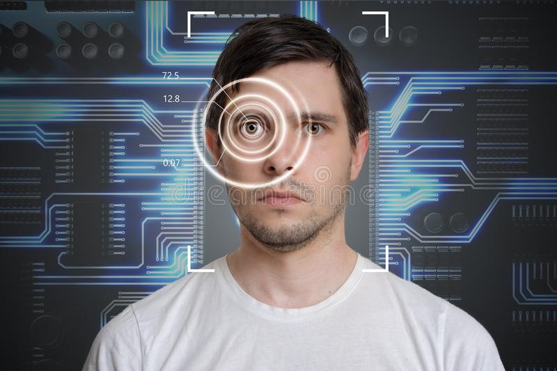 Face detection and recognition of man. Computer vision concept. Electronic circuit in background royalty free stock image