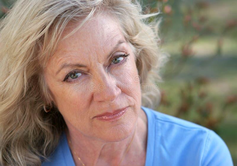 Face Of Distrust. A beautiful mature woman looking hurt and distrustful stock photos
