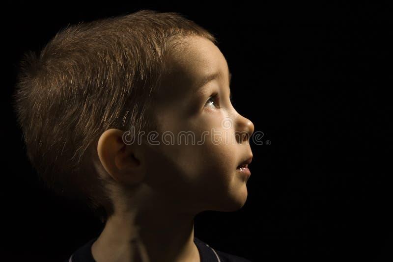 Face do bebê em um preto foto de stock royalty free