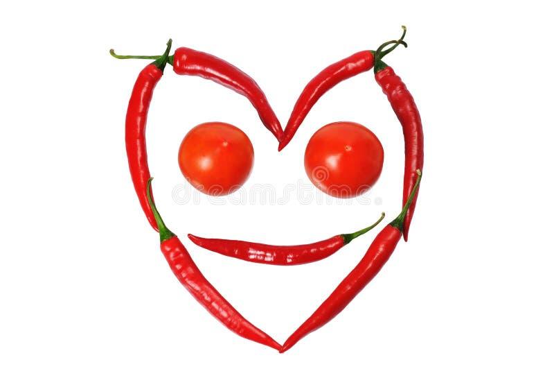 Face do paprica e dos tomates fotografia de stock royalty free