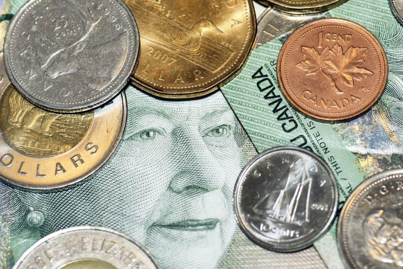 Face e moedas do dinheiro foto de stock royalty free