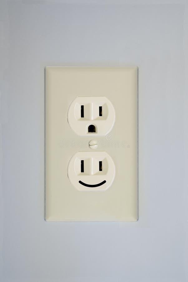 Face elétrica do smiley da tomada fotografia de stock