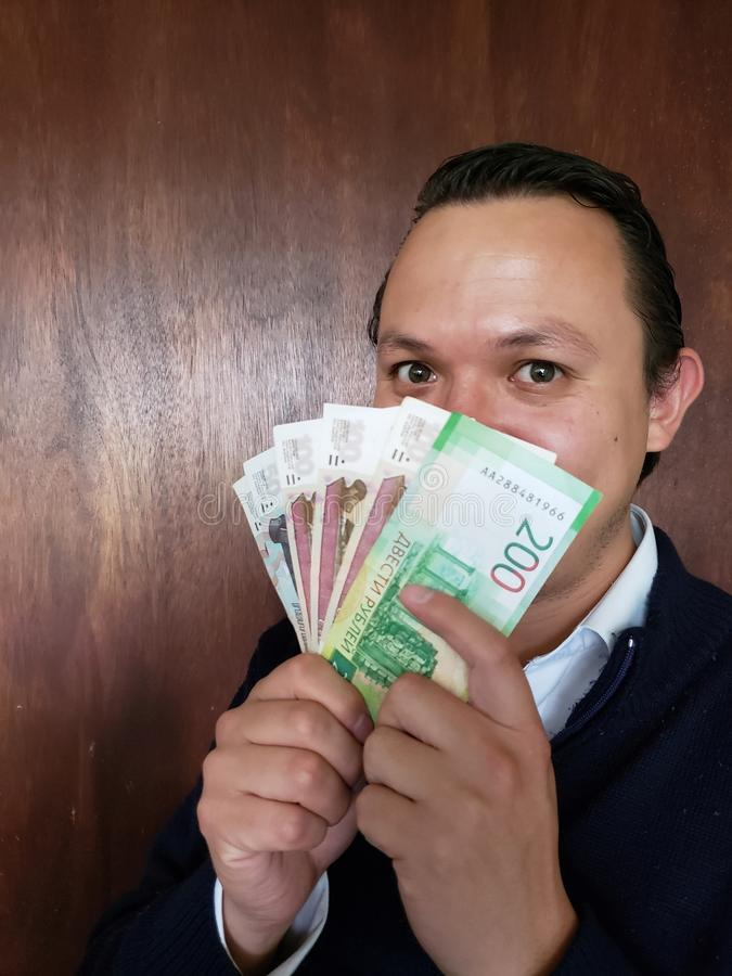 face with emotion expression of a young man with Russian banknotes royalty free stock photos