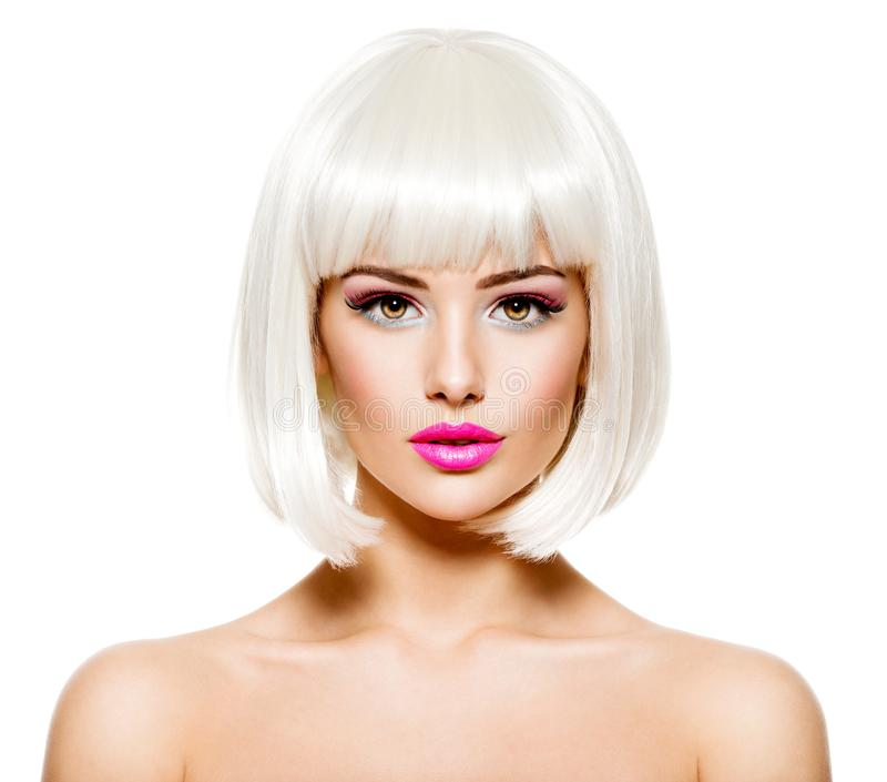 Face of a fashion model with bright pink make-up and bob hairstyle. Beautiful face of a fashion model with bright pink make-up stock photography