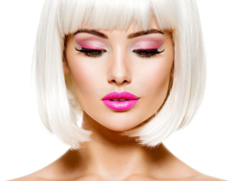 Face of a fashion model with bright pink make-up and bob hairstyle. Beautiful face of a fashion model with bright pink make-up royalty free stock images