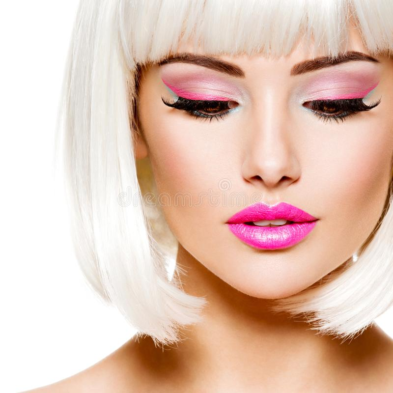 Face of a fashion model with bright pink make-up and white hairs. Beautiful face of a fashion model with bright pink make-up stock images