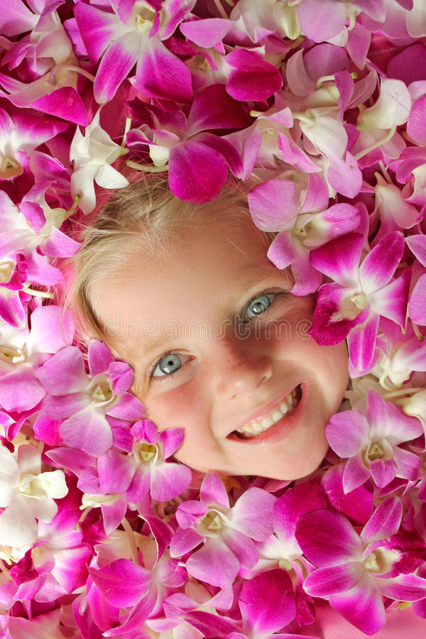 Face Floating in Flowers stock photo