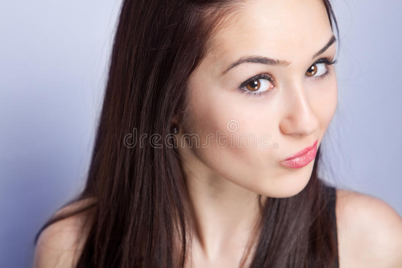 Face of funny playful young woman. Face of funny playful young brunette woman stock images