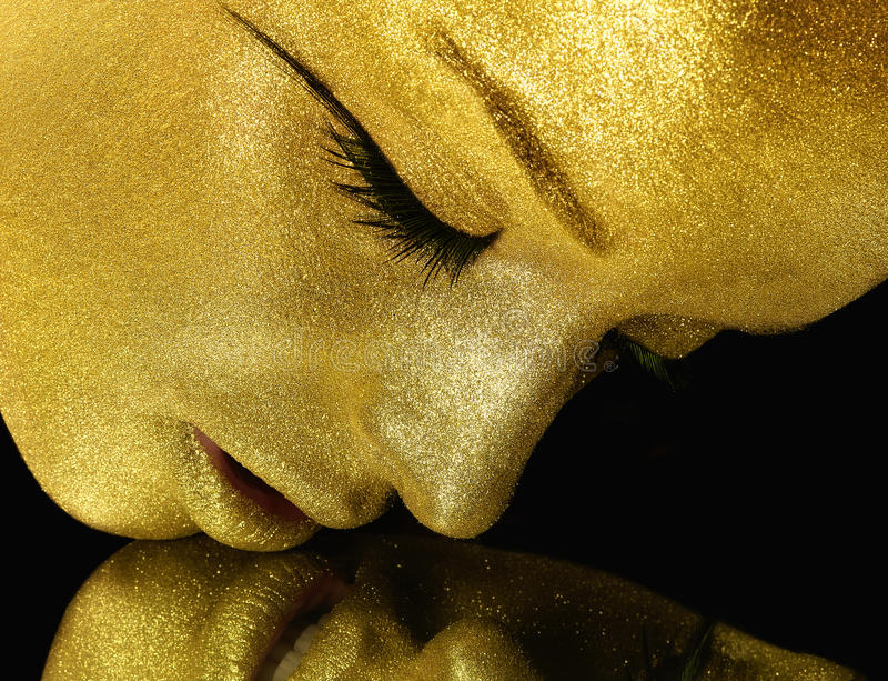 Face with gold glitter royalty free stock photography