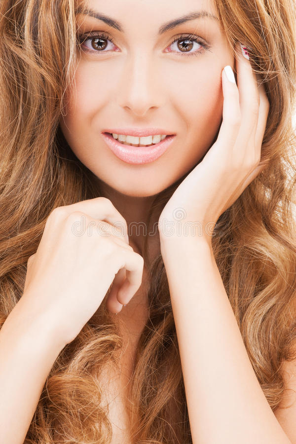 Face and hands of happy woman with long hair