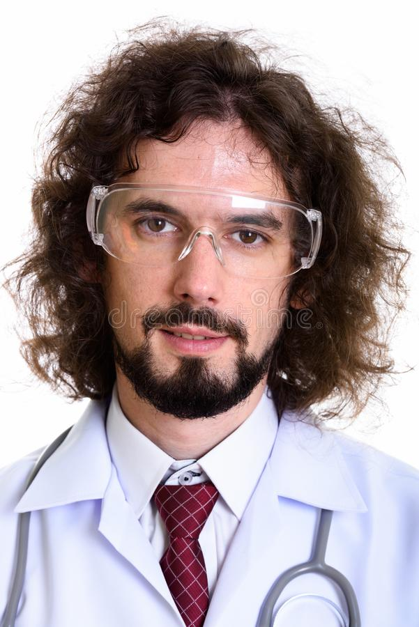 Face of happy man doctor smiling while wearing safety glasses stock photos