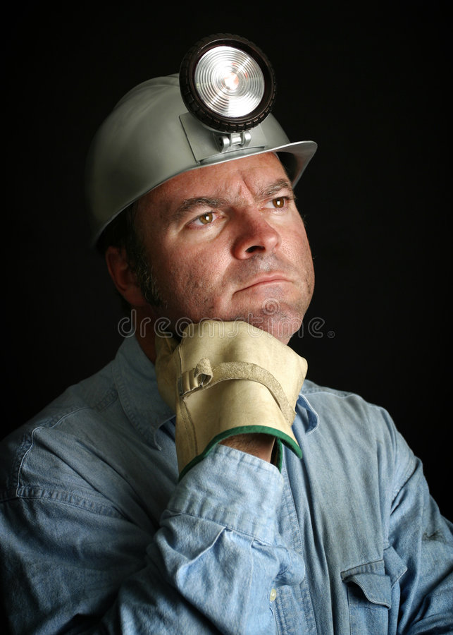 Face of Hard Work. A portrait of a coal miner who's dirty face reflects years of hard work stock photography