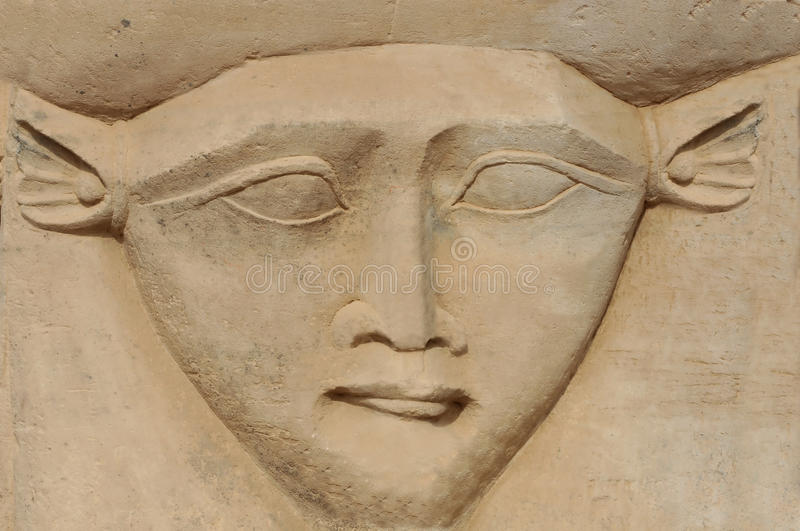 The face of Hathor. Ancient Egyptian sculpture of the fertility and love goddess hathor from her temple at Dendera, in Egypt royalty free stock image