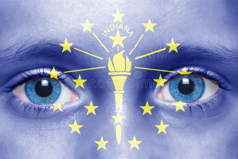 Face with indiana state flag. Human`s face with indiana state flag royalty free stock photos