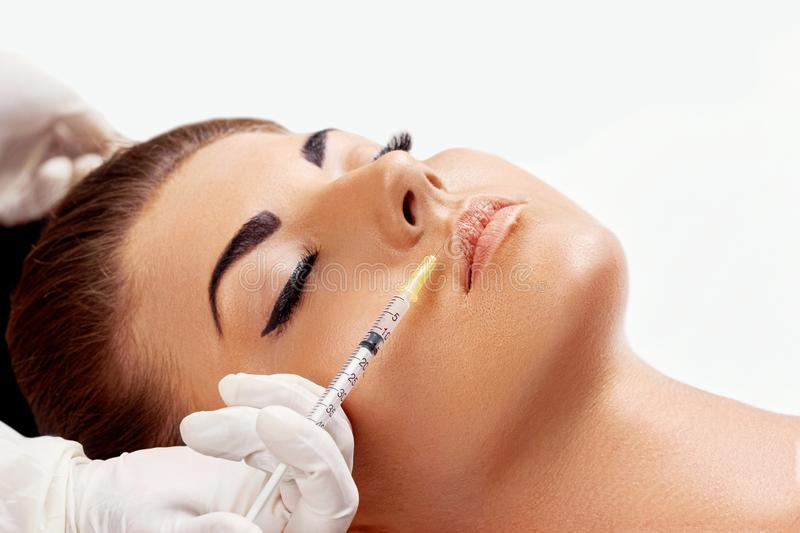 Face Injection. Woman getting cosmetic injection of botox in lips, closeup. royalty free stock image
