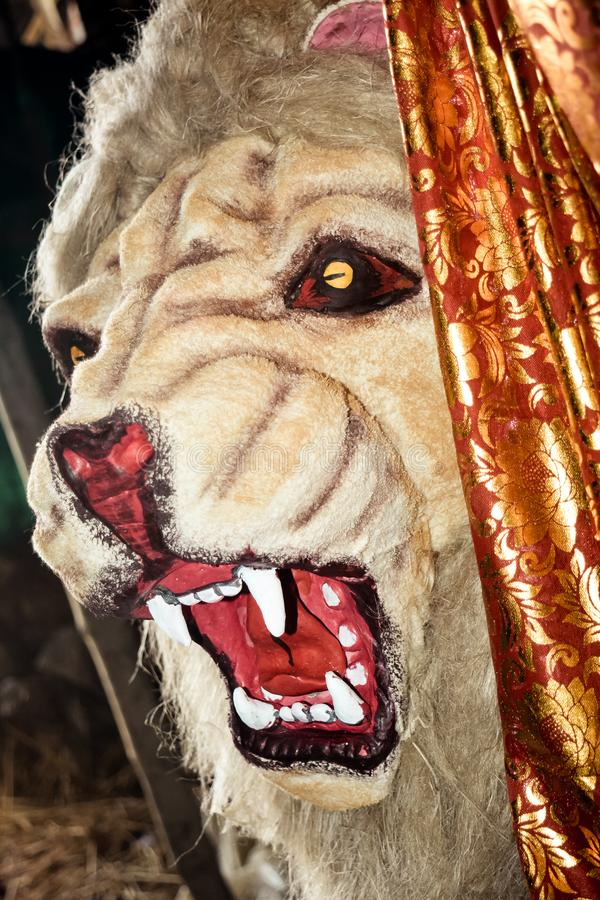 The face of a lion, often referred as king of jungle. Displays with a cute, cartoon style during durga puja festival artwork. It royalty free stock photo