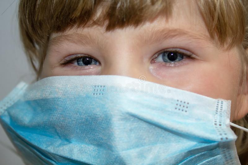 The face of a little girl in a medical mask. Protection from viruses. Close-up royalty free stock photos