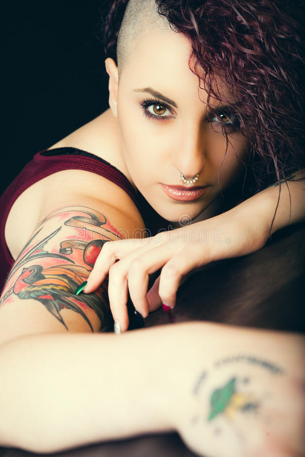 Face makeup and tattoos, punk girl make-up. Hair shaved royalty free stock photography