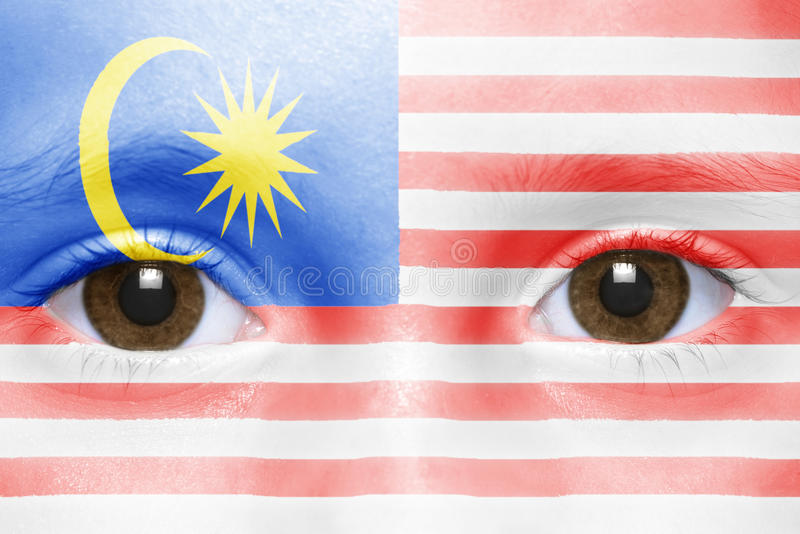 face with malaysian flag royalty free stock photos