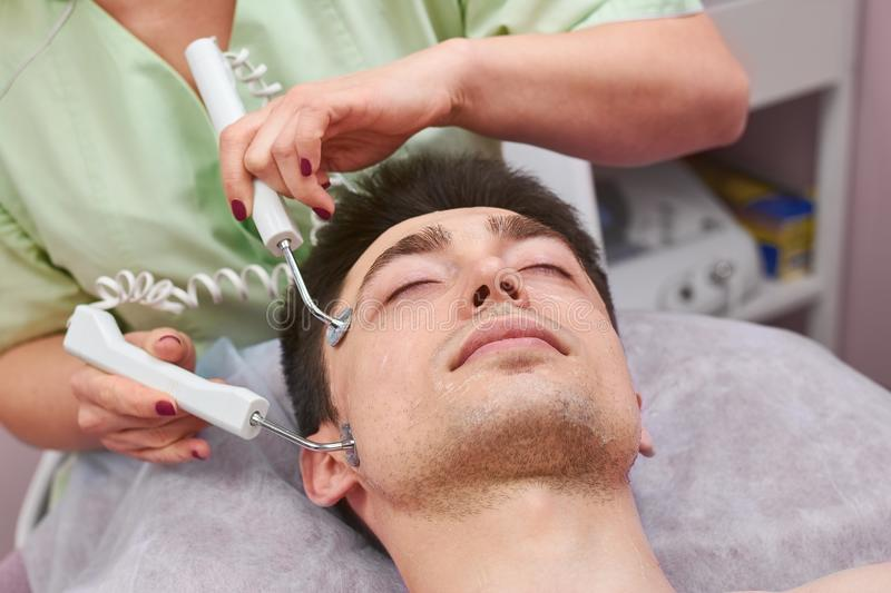 Face of man, microcurrent therapy. stock photos