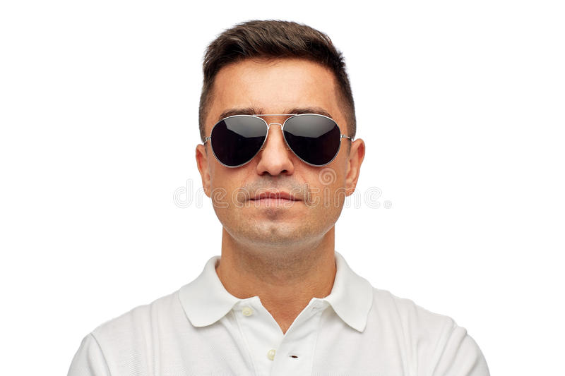Face of man in polo t-shirt and sunglasses. Summer, accessories, style and people concept - face of middle aged latin man in white polo t-shirt and sunglasses stock image