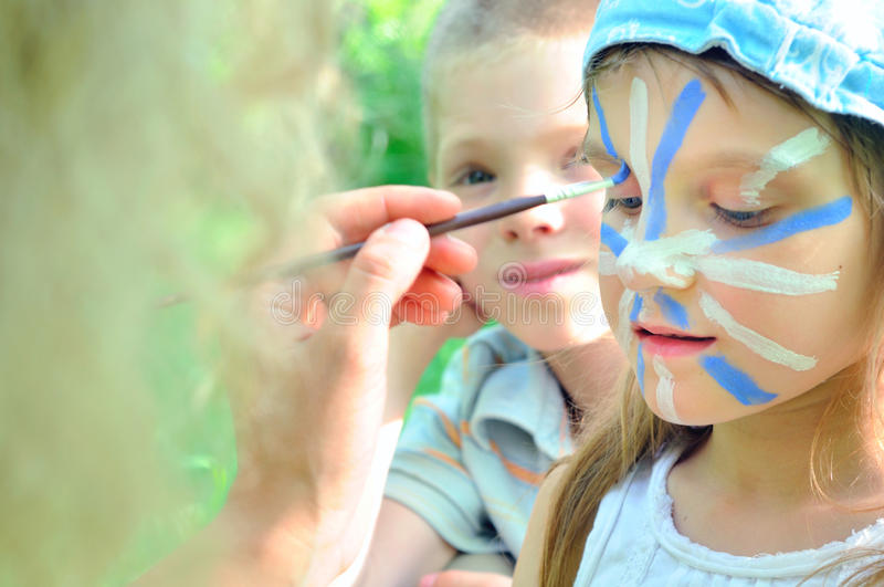 Face mask cjild carnival painting stock images