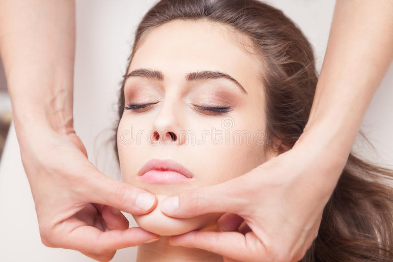 Face massage stock photography