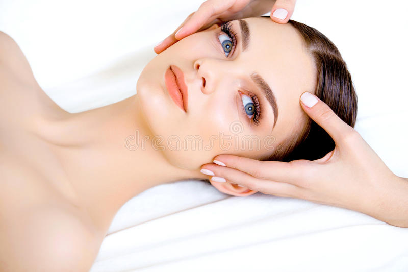 Face Massage. Close-up of a Young Woman Getting Spa Treatment. royalty free stock photography