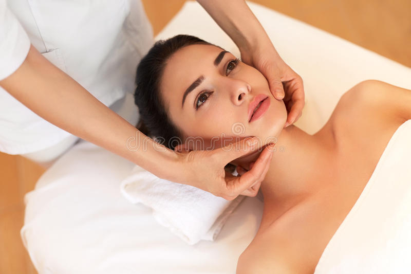 Face Massage. Close-up of a Young Woman Getting Spa Treatment. Face Massage. Close-up of a Young Woman Getting Spa Treatment royalty free stock photo