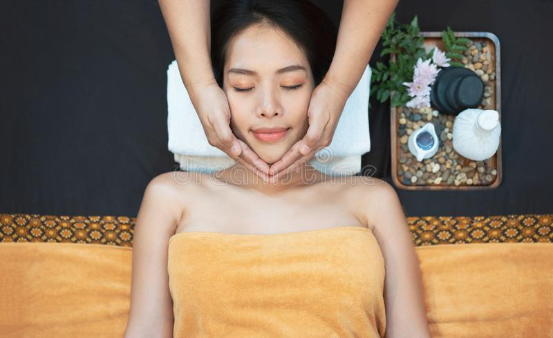 Face massage. Close-up of young woman getting spa massage treatment at beauty spa salon. Spa skin and body care. Facial beauty royalty free stock photo